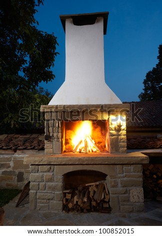 Fireplace in rural house backyard, barbecue grill for roasting food