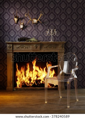 Fireplace room. Chimney with chair and woodpile. Chimney place. - stock photo