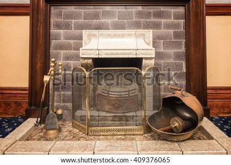 Fireplace with accessories - stock photo