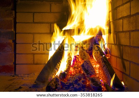 Fireplace with burning logs. - stock photo