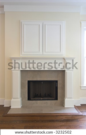 fireplace with closed wall cabinet for flatscreen tv. Can be paired with 3232495 - stock photo