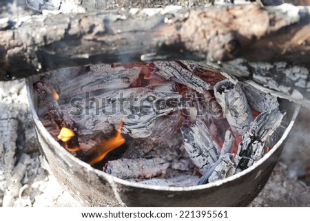 Fireplace with coals burning down - stock photo