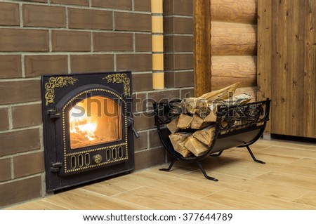 Fireplace with firewood basket - stock photo