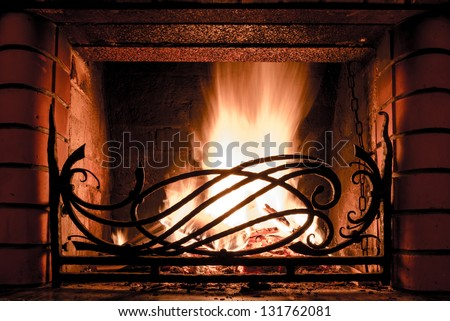fireplace with iron grate - stock photo