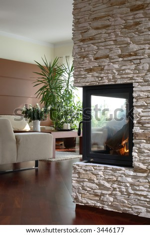 Fireplace with living room in the background - stock photo
