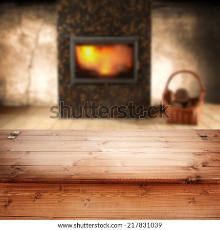 fireplace with table of brown wooden box  - stock photo