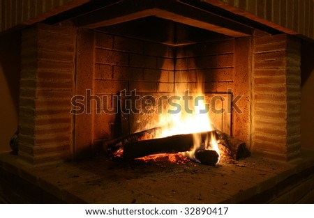 Fireplace wood fire in small villa in tuscany - stock photo