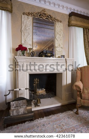 fireside. Beautiful fireplace in a drawing room. An interior of the magnificent house.