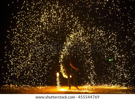 Firestarter performing amazing fire show at Koh Samed. Thailand - stock photo