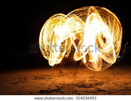 Firestarter performing amazing fire show nightlife at ao-nang be - stock photo