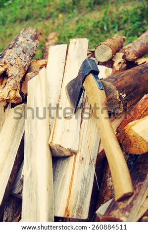 Firewood and axe - stock photo
