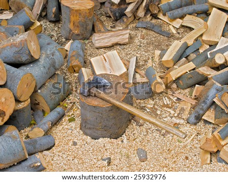 firewood choping in backyard for home heating - stock photo