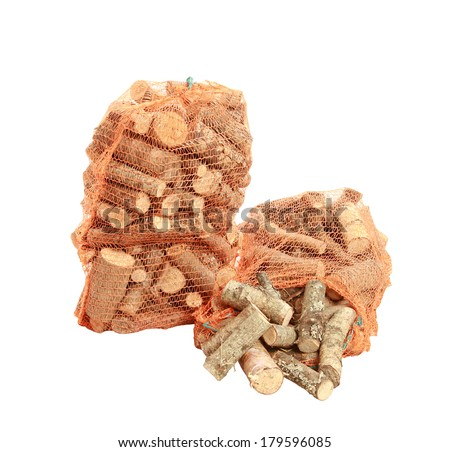 firewood in net bag isolated on white background  - stock photo