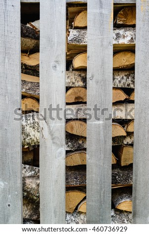 firewood in stack of wood as background