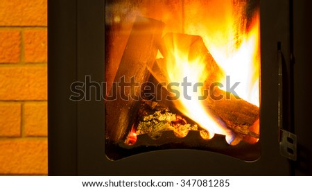 Firewood in the fireplace. - stock photo