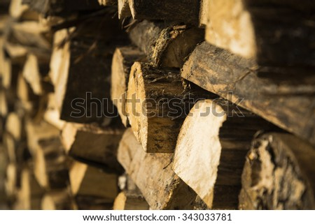 Firewood pile background - stock photo