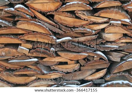 firewood stack. Staple of biomass, arranged firewood - stock photo