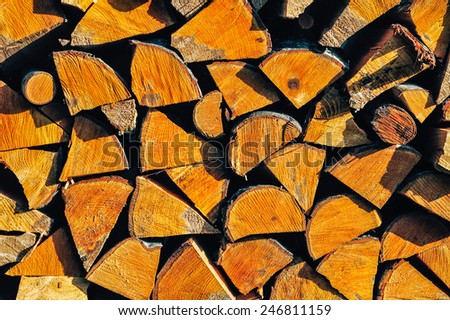 Firewood stacked up on top of each other - stock photo