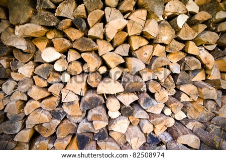 Firewood stock of a round tree trunks