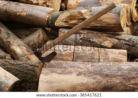 firewood with ax in stump, background and texture, beech wood - stock photo