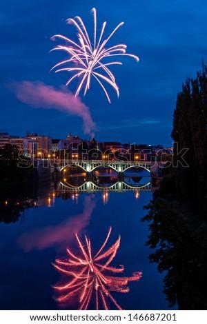 Firework above Old bridge over Elbe river in Kolin, Czech Republic  - stock photo