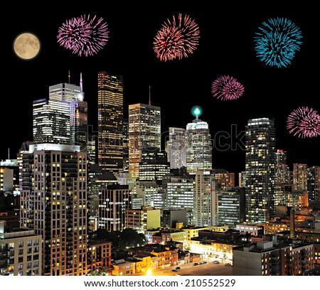 Firework above the modern city center. - stock photo