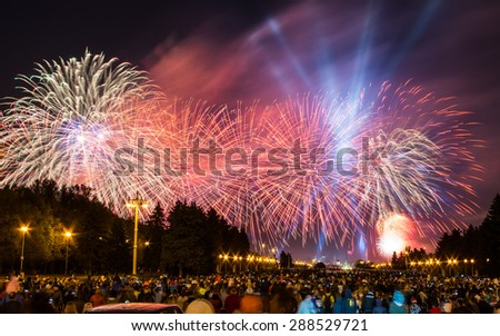 Firework and laser show marking the 70th anniversary of victory in the Great Patriotic War (World War II) at 9th of may 2015. View of the Sparrow hills from Lomonosov Moscow State University.  - stock photo