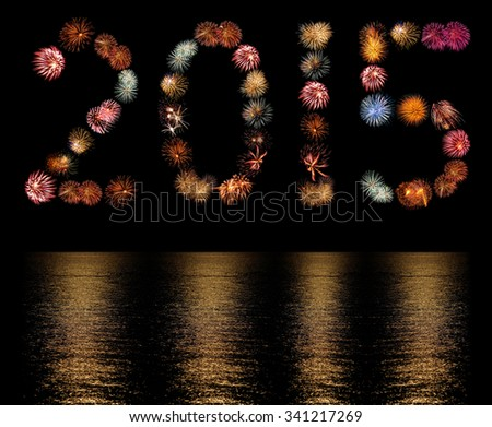 Firework Bursts Arranged as the Number 2015 with Reflections - stock photo