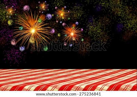Firework celebration on dark background with Picnic Table. - stock photo