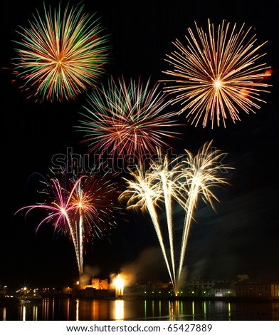 Firework display above King Johns Castle and the river Shannon, Limerick City Ireland. - stock photo