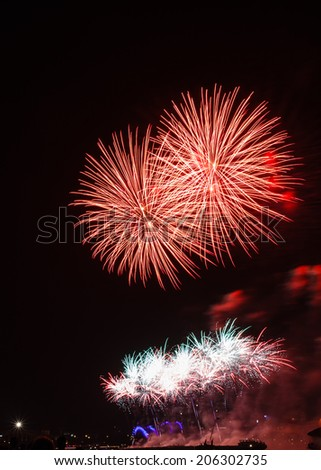 Firework in red and white colors, Cologne, Germany