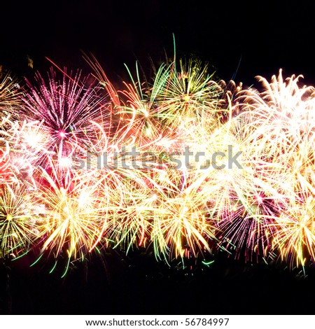 Firework streaks in night sky, celebration background - stock photo