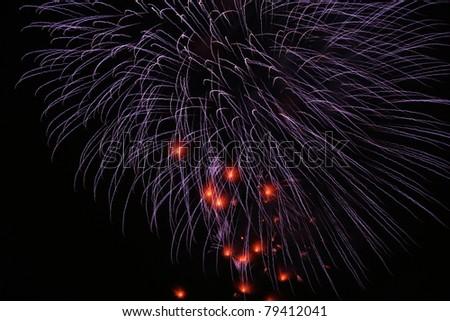 Firework streaks in the dark night - stock photo