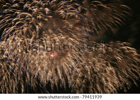 Firework streaks in the dark sky - stock photo