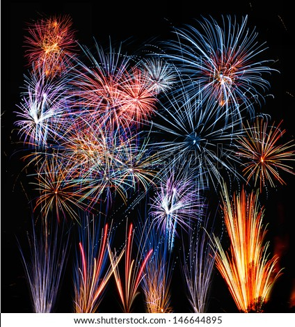 Firework streaks in the night sky. Spectacular pyrotechnic show by professional team - stock photo