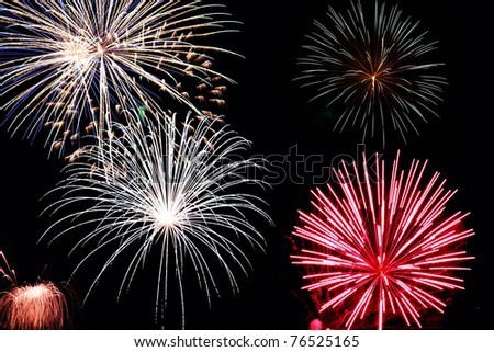 Fireworks against a black background. - stock photo