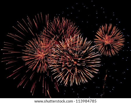 Fireworks against a night sky - stock photo