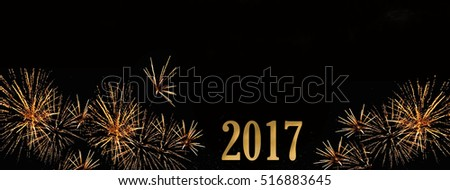 fireworks and golden figures 2017 on black background