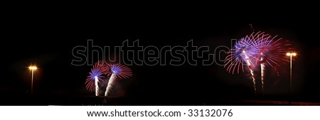Fireworks and Lights from a Bridge - stock photo