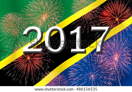 Fireworks and 2017 on the  TANZANIA flag.Concept Happy New Year 2017 for a background .