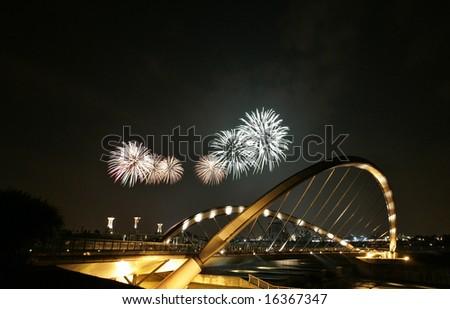 Fireworks are being displayed over Putrajaya dam in Putrajaya, Malaysia. - stock photo