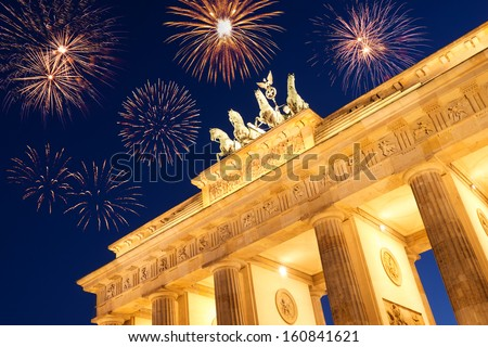 fireworks at brandenburger tor on new year's eve - stock photo