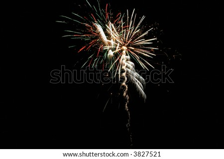 fireworks at night in the black sky - stock photo