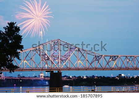 Fireworks by Ohio River by Kentucky/Indiana border bridge on Ohio River - stock photo