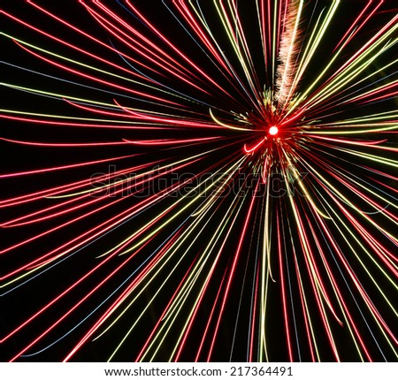 fireworks,colored splashes of light against a dark background