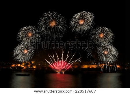 Fireworks. Colorful amazing fireworks with Valletta city background, big amazing explosion and house light in Valletta, Malta fireworks festival, 4 July, Independence day, New Year, magic light art - stock photo