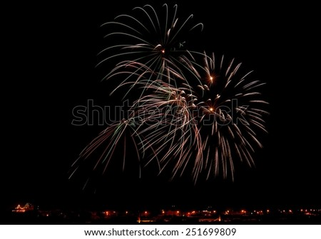 Fireworks,colorful fireworks, fireworks explosion in dark sky with city silouthe on bottom,long exposure,Independence day,explode, Malta fireworks festival, New Year, 4 of July - stock photo