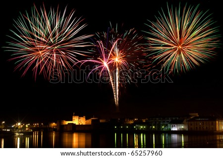 Fireworks display above King Johns Castle and the river Shannon, Limerick City Ireland. - stock photo