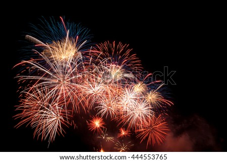 Fireworks display going off in the bay. - stock photo