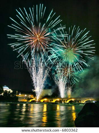 Fireworks display in the Italian city of Turin over the river Po - stock photo